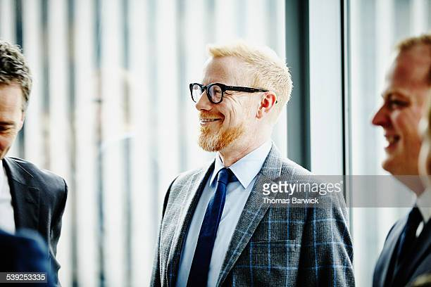 Smiling business executive in informal meeting