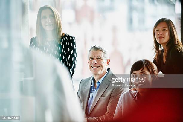Smiling business executive in meeting in office