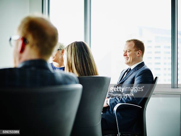 Smiling business executive in meeting