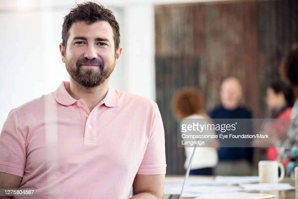 smiling business man in business meeting - photography stock pictures, royalty-free photos & images