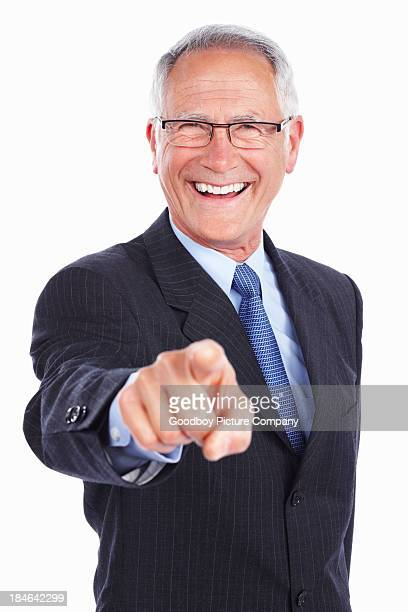 Smiling business man pointing at you