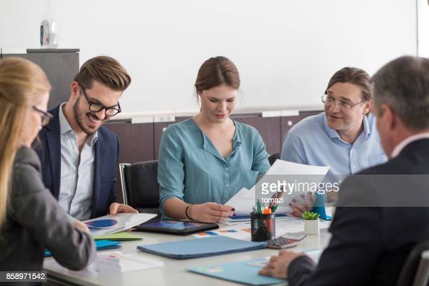 Smiling business people at meeting table