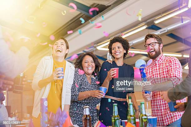 smiling business people at office party - celebration stock pictures, royalty-free photos & images
