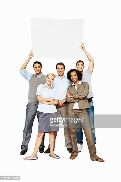 Smiling business people holding a blank billboard