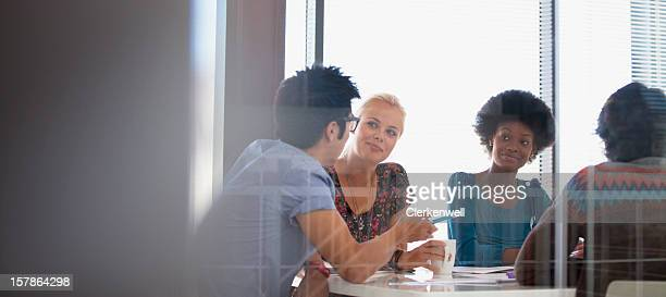 smiling business people meeting in conference room - casual clothing stock pictures, royalty-free photos & images