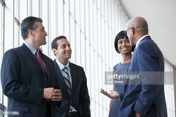 smiling business people talking - american influenced stock photos and pictures