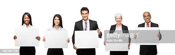 Smiling business people with commercial signs