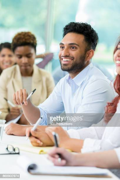 Smiling business professional attends finance conference
