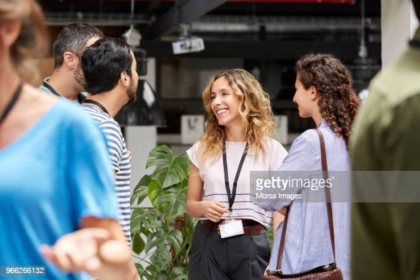 smiling business team standing during meeting - conference stock pictures, royalty-free photos & images