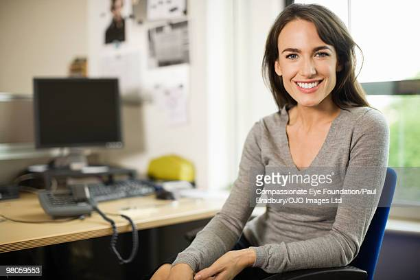 Smiling business woman at a desk