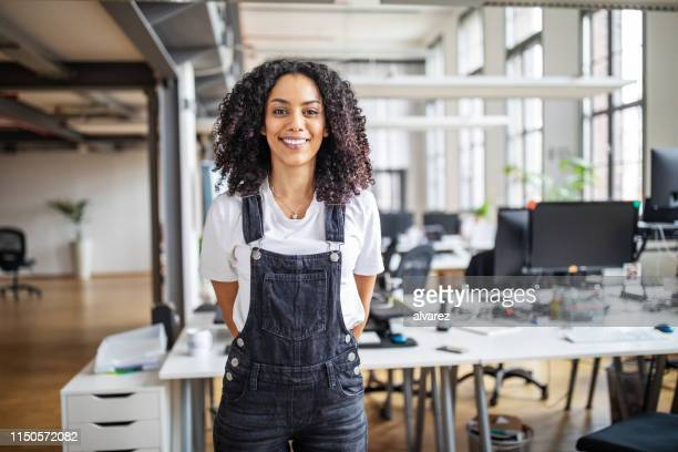 smiling business woman in casuals - dungarees stock pictures, royalty-free photos & images