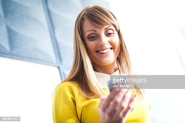 smiling business woman on her smart phone