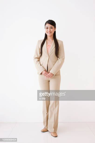 smiling business woman - beige suit stock pictures, royalty-free photos & images