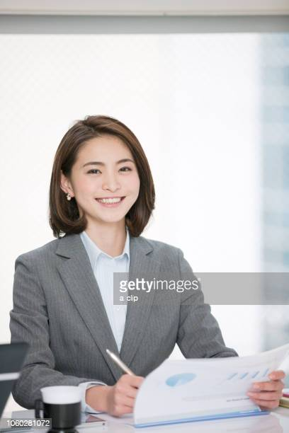 smiling business woman - formal businesswear stock pictures, royalty-free photos & images