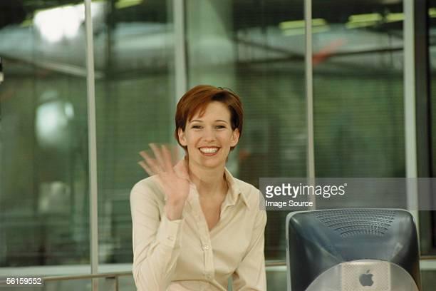 smiling business woman - winken stock-fotos und bilder