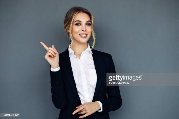 smiling business woman showing something on her hand - gesturing stock pictures, royalty-free photos & images