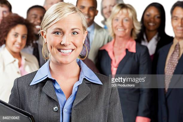 Smiling Business Woman with team