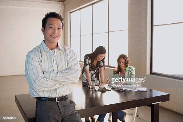 Smiling businessman and businesswomen in meeting