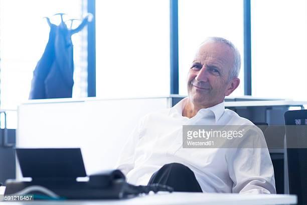Smiling businessman at desk