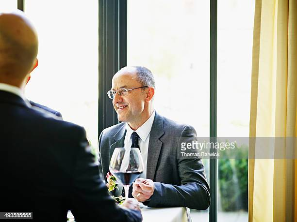 Smiling businessman at lunch meeting in restaurant
