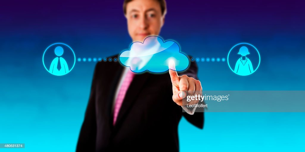 Smiling Businessman Contacting Workers Via Cloud : Stock Photo
