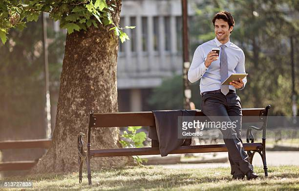 Smiling businessman drinking coffee