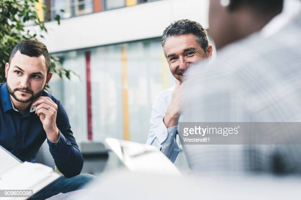 Smiling businessman having a meeting with colleagues