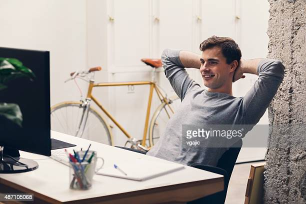 Smiling Businessman in his office.
