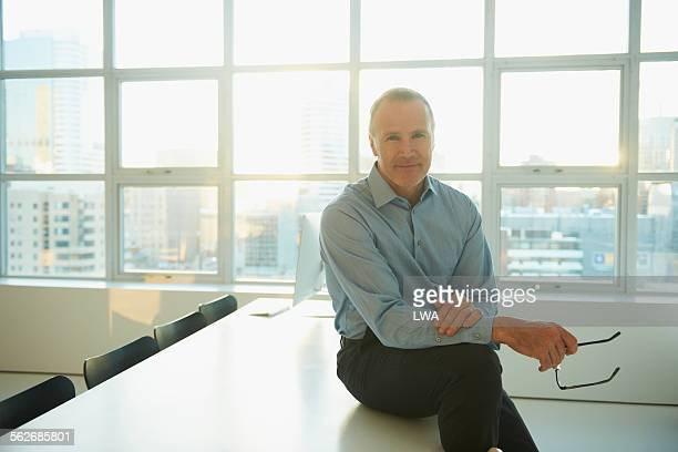 Smiling businessman in modern office