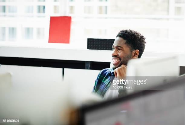Smiling businessman in office discussion