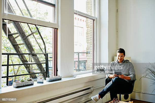 Smiling businessman in startup office