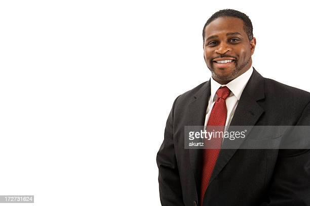 Smiling businessman in suit against a white background