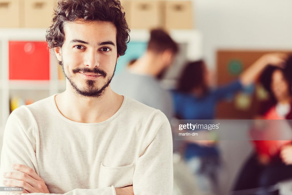 Smiling businessman in the office : Stock Photo