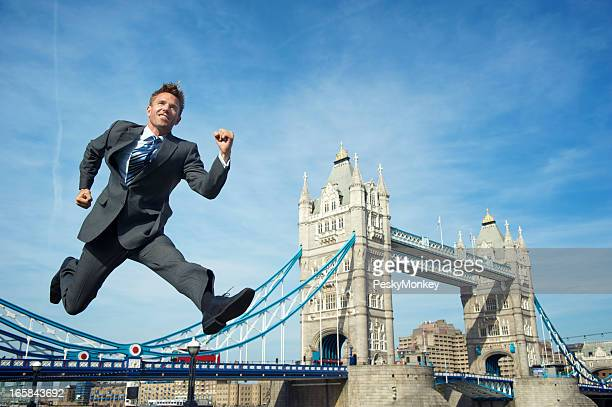 Smiling Businessman Jumps Over Tower Bridge London