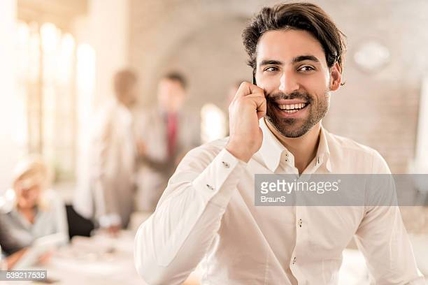 Smiling businessman on the phone.