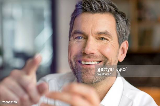 Smiling businessman using futuristic portable device