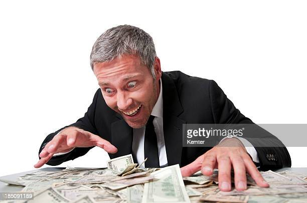 smiling businessman with dollar bills - greed stock pictures, royalty-free photos & images