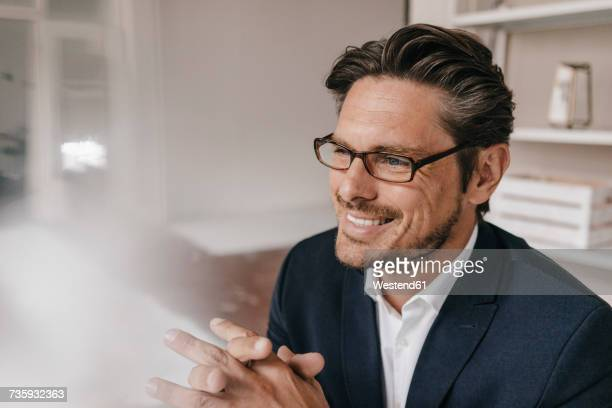 Smiling businessman with glasses