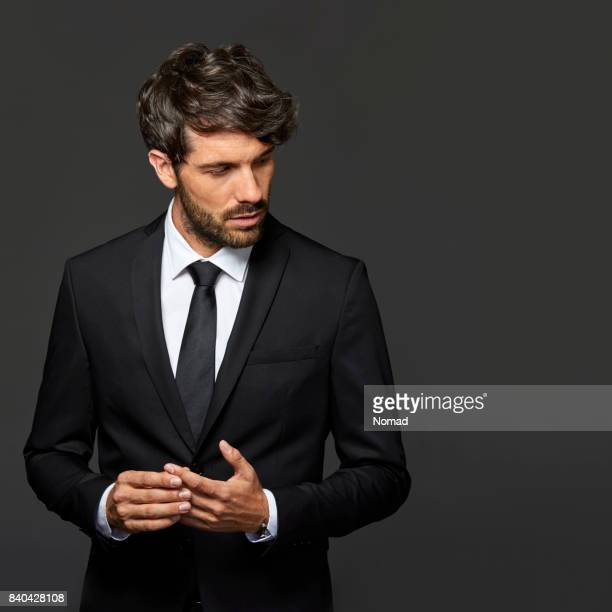 smiling businessman with hands clasped - blazer jacket stock pictures, royalty-free photos & images