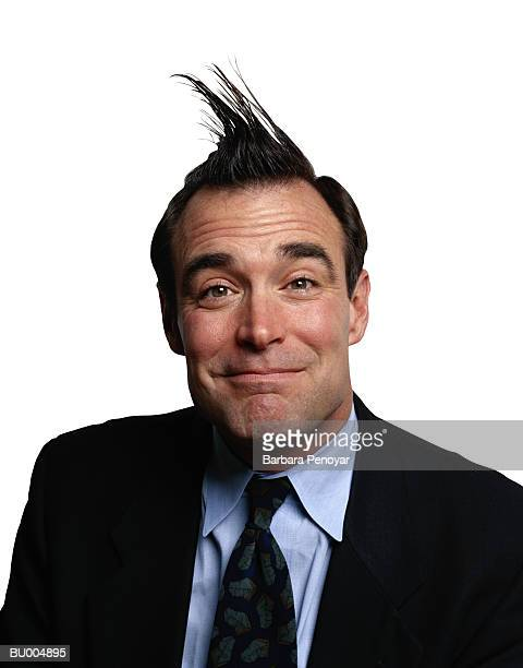 Smiling Businessman with His Hair Sticking Up