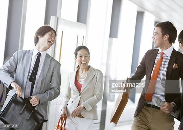 Smiling businessmen and businesswoman