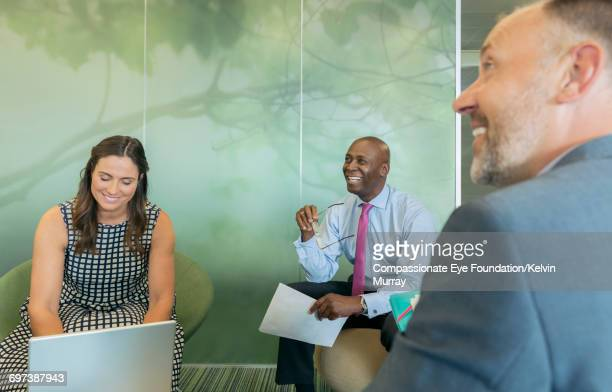 Smiling businesspeople in meeting in office