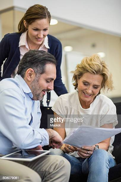 Smiling businesspeople planning strategy in office meeting
