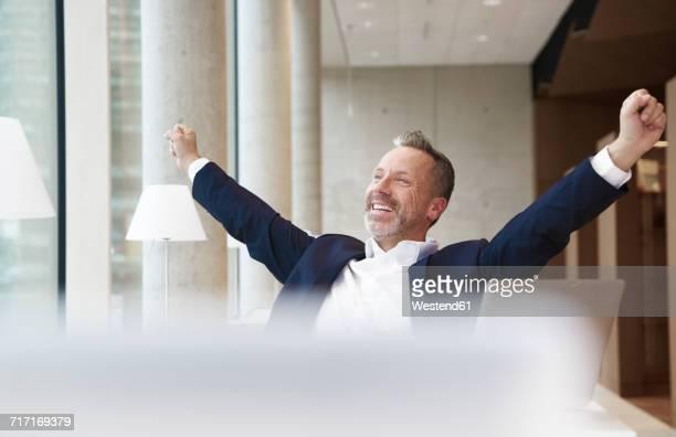Smiling businesssman stretching