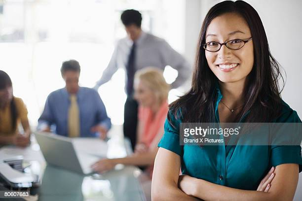 Smiling businesswoman at meeting