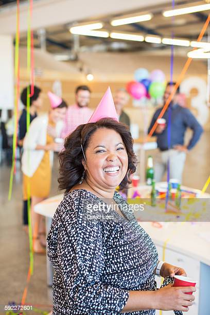 Smiling businesswoman at office party
