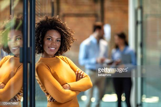 smiling businesswoman at work - authority stock pictures, royalty-free photos & images
