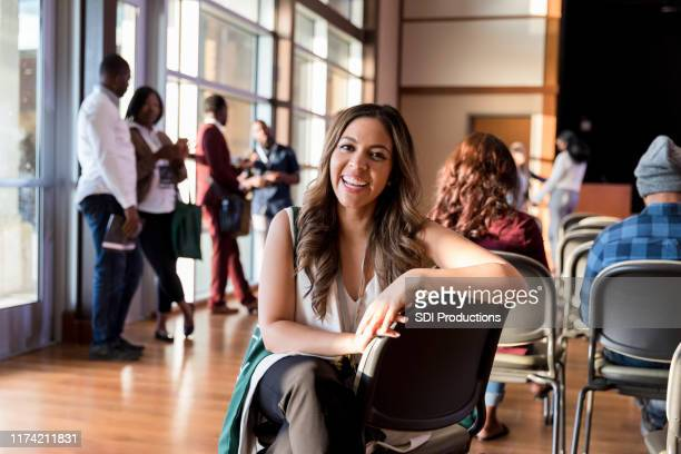smiling businesswoman attending conference - incidental people stock pictures, royalty-free photos & images