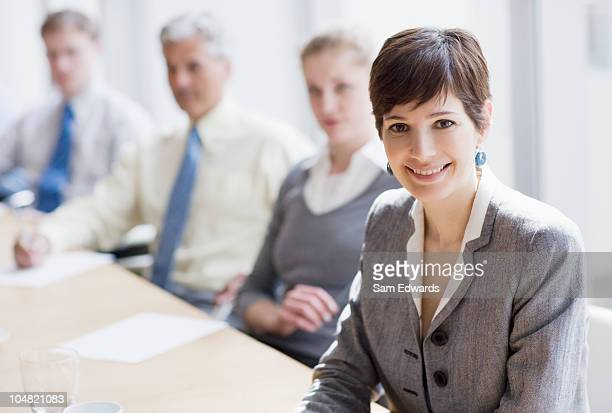 smiling businesswoman in conference room - juror law stock pictures, royalty-free photos & images