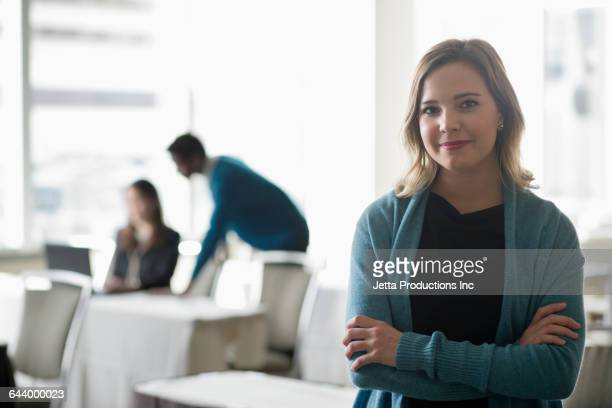 Smiling businesswoman in convention room